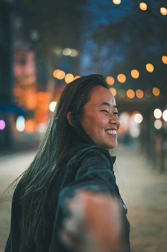 person follow me photography of smiling woman smile