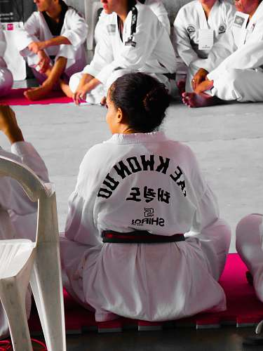 photo person girl wearing karate gi sitting on pink puzzle mat people free for commercial use images