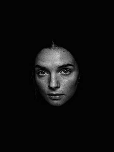 black-and-white grayscale photography of woman looking straight face