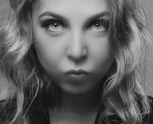 person greyscale photo of woman face