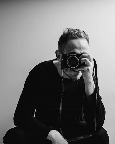photo person man holding DSLR camera black-and-white free for commercial use images