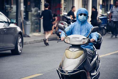 photo person person driving motor scooter automobile free for commercial use images