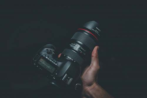 photo photography person holding black Canon DSLR camera grey free for commercial use images