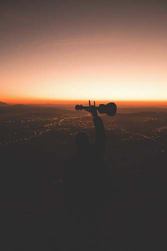 photo person silhouette photography of person holding guitar photo free for commercial use images
