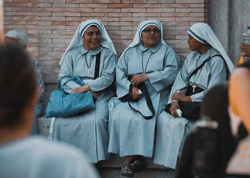 person three nuns sitting apparel
