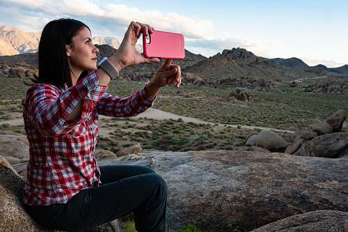 photo person woman sitting holding smartphone face free for commercial use images