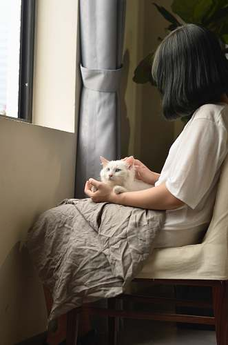 person woman sitting with cat on lap doctor