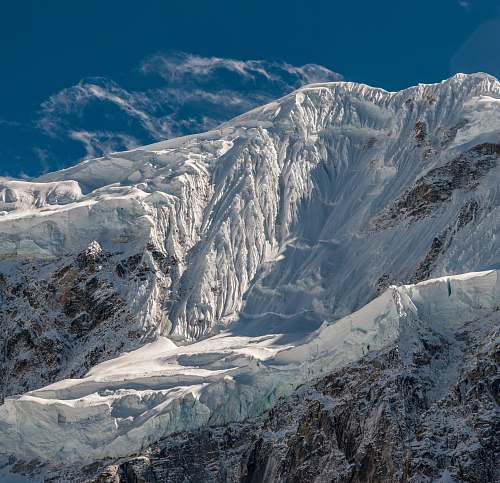 mountain brown stone mountain covered by snow glacier
