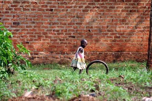 photo brick girl playing bike wheel child free for commercial use images