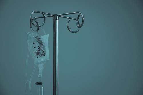 health dextrose hanging on stainless steel IV stand treatment
