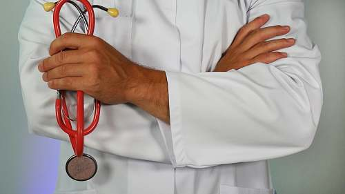 photo doctor doctor holding red stethoscope person free for commercial use images