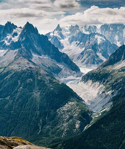 nature aerial view photography of mountains under cloudy sky glacier