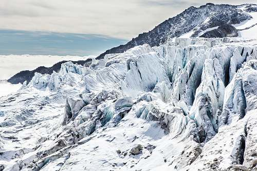 ice mountain covered with snow at daytime glacier