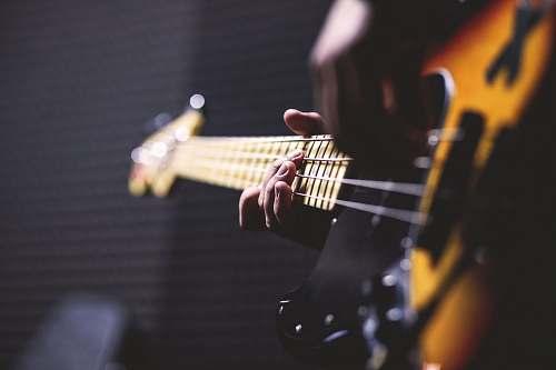 guitar closeup photo of person playing guitar electric guitar