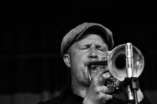 black-and-white grayscale photo of musician trumpet