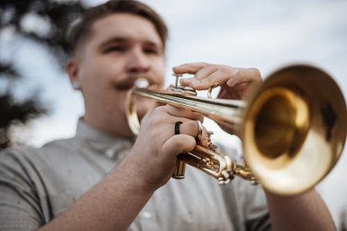 people man playing trumpet outdoors musical instrument