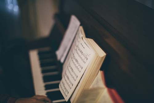 photo book opened music sheet book on top of upright piano piano free for commercial use images