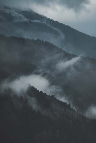 grey mountain covered by fog isolaccia