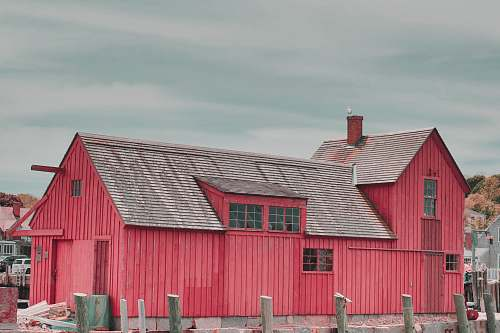 outdoors red wooden shed barn