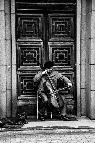 human illustration of person playing cello black-and-white