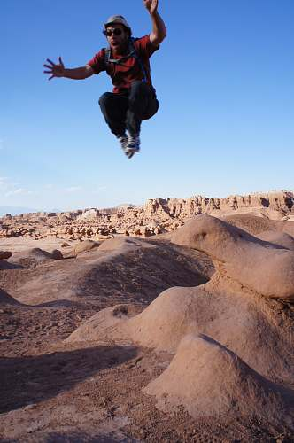 photo human man jumped on desert during daytime person free for commercial use images