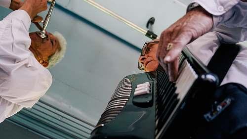 human man playing accordion person