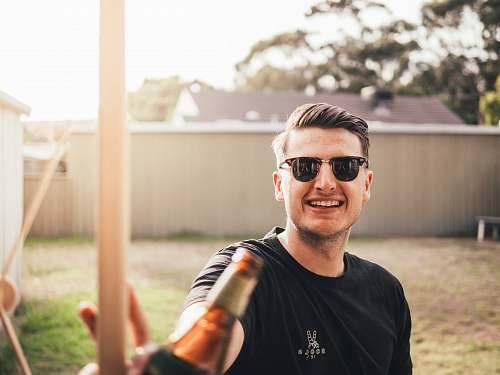 human man smiling while taking photo person