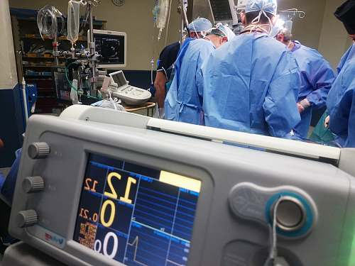 photo human doctors doing surgery inside emergency room medical free for commercial use images