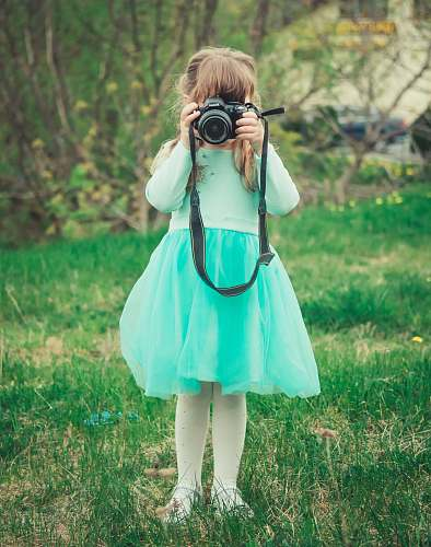 photo human girl holding black DSLR camera photo free for commercial use images