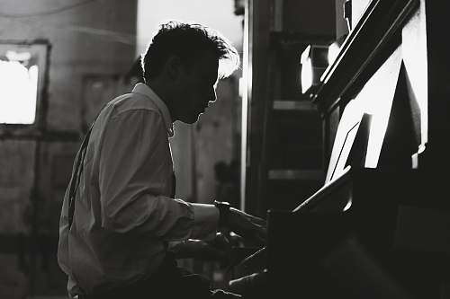 music grayscale photography man playing piano black-and-white
