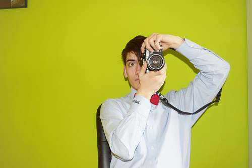 human man holding DSLR camera people