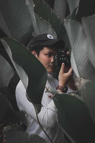human man in black cap photography