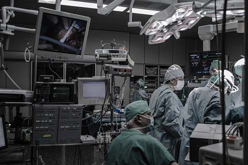 human people wearing surgical clothes inside operating room people