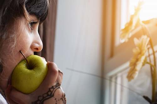human woman biting apple people