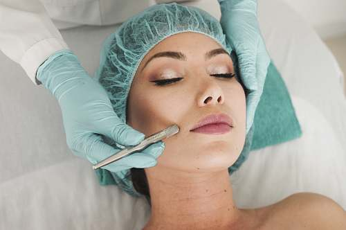 photo human woman doing liposuction on her face face free for commercial use images