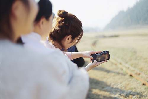 photo human woman using smartphone photo free for commercial use images