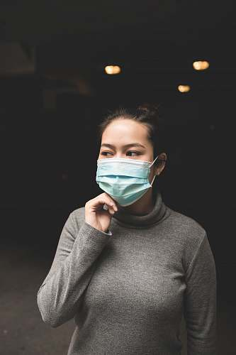 human woman wearing teal mask and gray turtle-neck shirt people