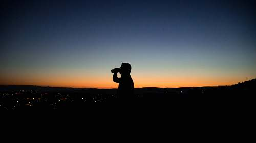 photo silhouette photo of man about to drink photographer