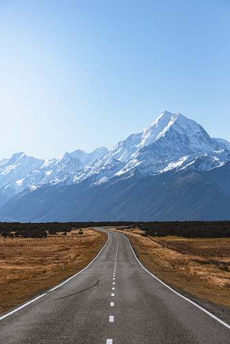 new zealand mountains covered with snow near road mount cook