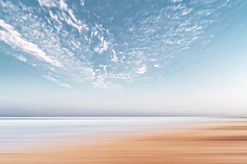 sky time lapsed photography of cumulus clouds sand