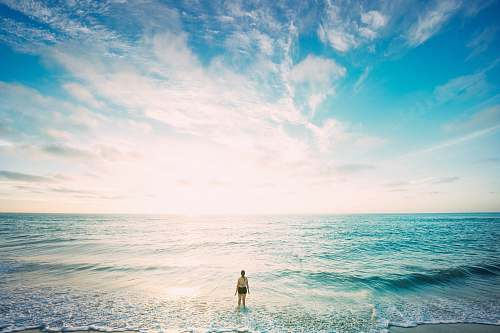 water woman on sea in front of sun ocean