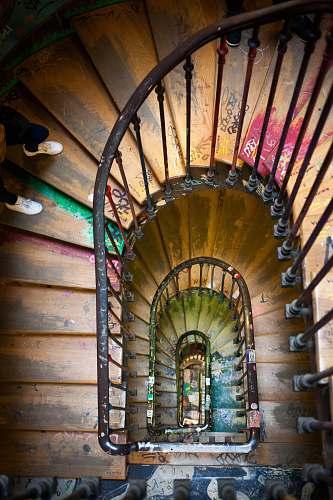 paris black metal framed brown wooden spiral ladder stair
