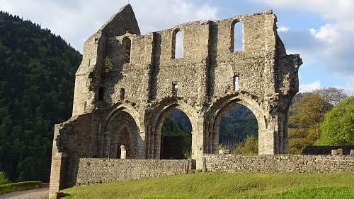ruins gray concrete wall at daytime 961 route de l'abbaye