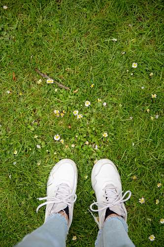 apparel unknown person stepping on grass grass clothing