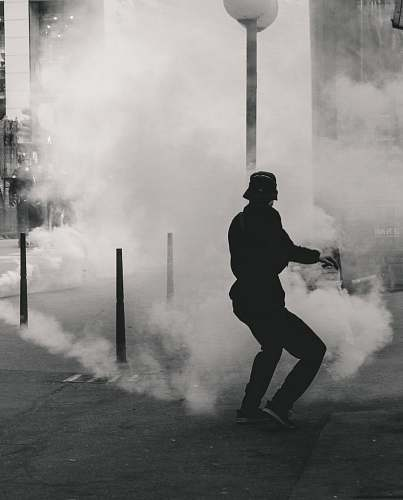 human man standing near smoke person