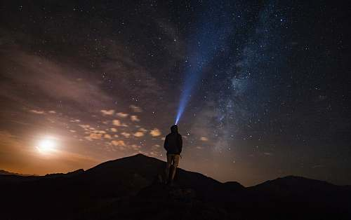 outdoors man standing at mountain peak under starry night sky human