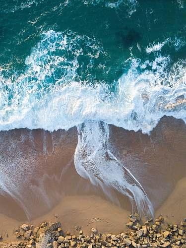 water top view of ocean wave on seashore sea