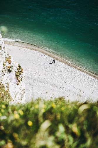 france aerial photography of a human on seashore beach