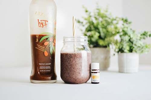cosmetics clear glass jar with brown liquid inside deodorant