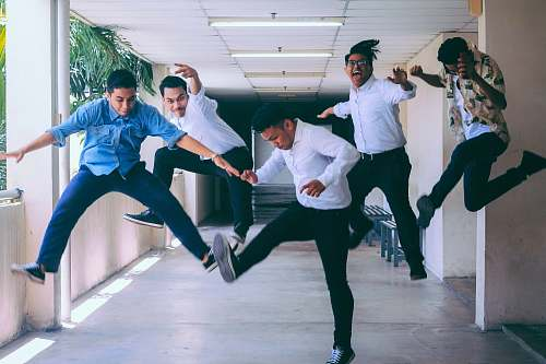 human group of people doing jump shot photography person